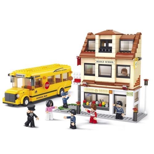 Image of Sluban school bus with elementary school (6938242951979)